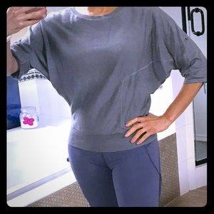 Sweater with dolman sleeves.